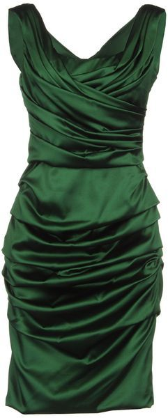 this green with satin but flairs out in crepe or chiffon below the hips with sequins on the edges of the beginning of the flair. no russing.  4/5/13