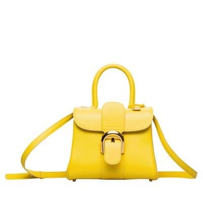 Mini bolso con cierre de hebilla y doble asa, de Delvaux.