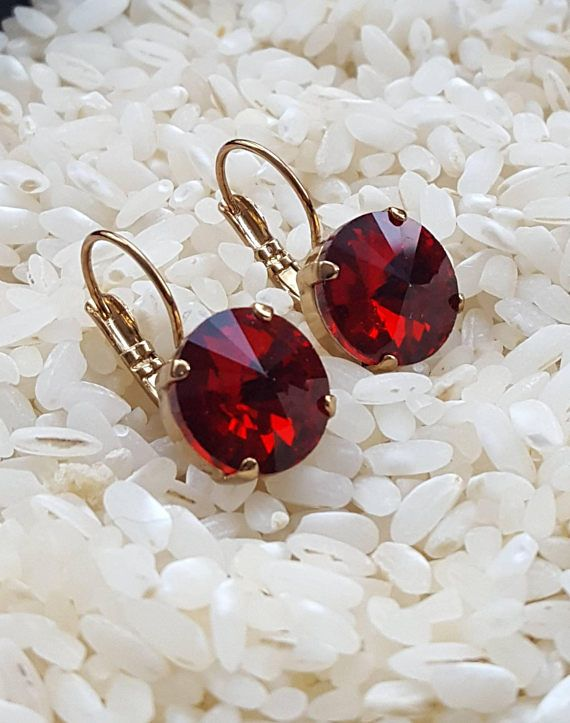 Check out this item in my Etsy shop https://www.etsy.com/ca/listing/578120271/red-glass-crystal-earrings-in-gold