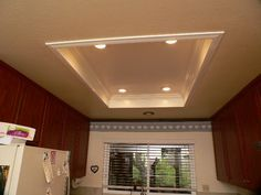 instead of hideous 70's flourescent ..recessed lights in and crown molding around.