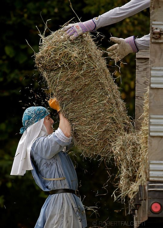 BETHLEHEM, CT- 11 OCTOBER 2005- Sister Alma Egger hoists a 40-50 lb. bale of hay in one of the 12 hay fields at the Abbey of Regina Laudis i...