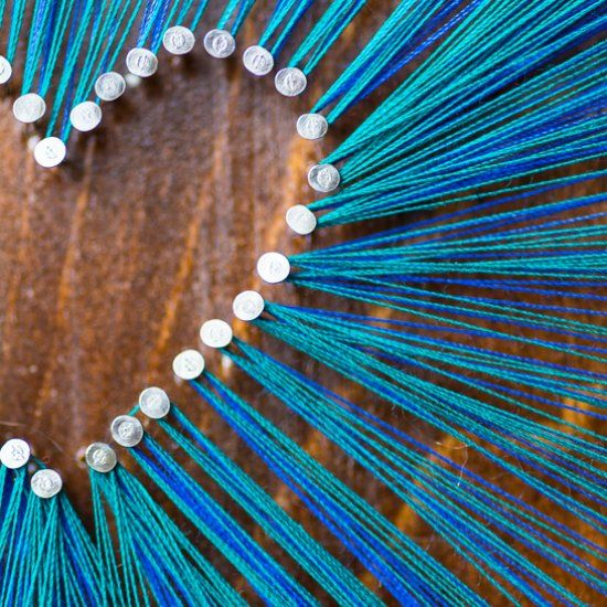See how I made a pretty string art design using a piece of stained scrap wood, nails, and regular sewing thread. A low-cost and easy craft!