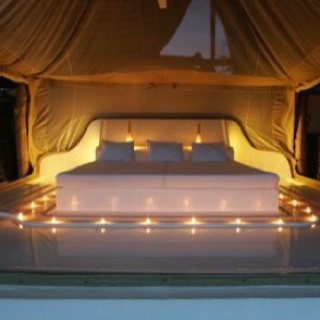 Romantic bedroom - candle lit bed