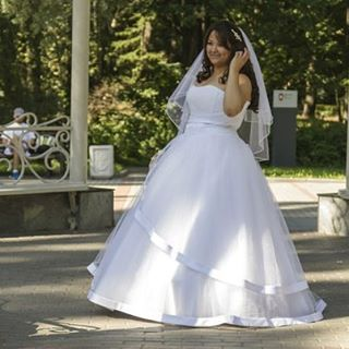 This strapless plus size wedding dress has a tiered ball gown style skirt. Get custom plus size #weddingdresses like this custom created with any modification you need from our Texas based design firm. You can also request a #replica of any haute couture bridal gown just in case the original is out of your price range.  Email us pictures for pricing from our site at www.dariuscordell.com