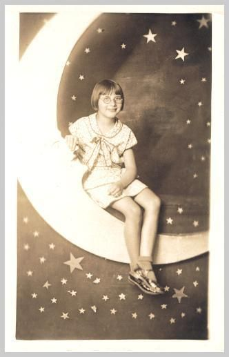 A young girl among the moon and stars