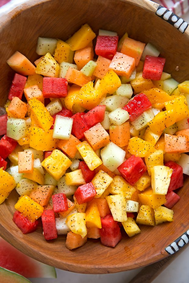 Mexican Fruit Salad - a fruit salad that combines watermelon, cantaloupe, honey dew, and mangoes that are tossed in a sweet spicy dressing
