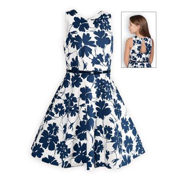 Abstract Navy Floral Tween Dress The Wooden Soldier Exclusive Flattering waisted dress has abstract navy floral print splashed against a cream background. Open keyhole back with single button closure at neckline. Full swing skirt accented with navy patent leather-like vinyl belt. Soft cotton sateen with a touch of spandex for added comfort. Hidden zip back closure. Above knee length. Fully lined.