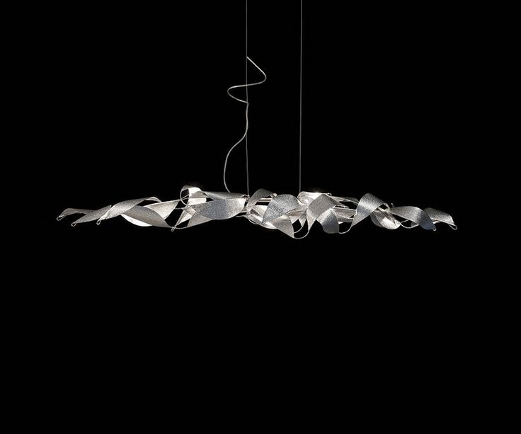 REFLEXION SKY; The Reflexion Suspension Light brings together nature and industry. Reflexion's body is made of stainless steel and features hand shaped aluminum leaves with a subtle texture. These leaves appear as if they are blowing in the wind giving the fixture life and a feel of movement • TPL LIGHTING • MERGING LIGHTING WITH DESIGN • TPLLIGHTING.COM • TORONTO, CANADA •