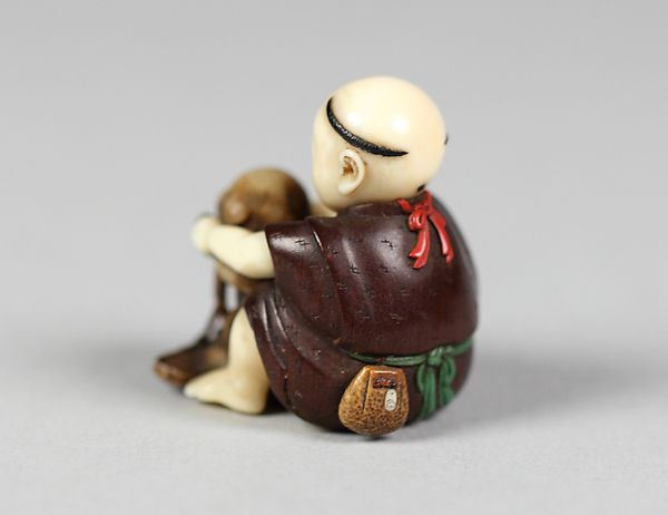 Netsuke of Boy Playing with a Dog | Japan | The Met