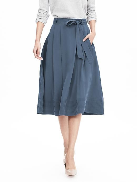 This belted blue midi skirt is made from Tencel for a super-soft feel and swingy silhouette, a perfectly polished addition to your winter wardrobe   Banana Republic