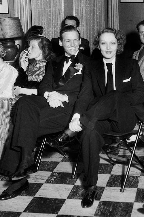 Katharine Hepburn, Douglas Fairbanks, Jr., and Marlene Dietrich attending a private screening at the home of Paramount executive Jesse L. Lasky, 1933