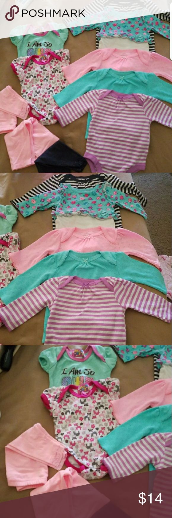 Baby Girl 10 piece Lot 0-3 months 10 piece. 5 long sleeve onesies four of which have never been worn, 2 short sleeve onesies, and  3 pairs of pants. All for $14 WOW thats less then $2 piece!!!  (Why Im selling so low?) Because it's time for me to buy my next set of clothes for my baby girl which is 3 to 6 months. !!!Bundle and save on shipping!!! One Pieces Bodysuits