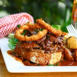 Roast beef smothered in delicious gravy topped with onion rings
