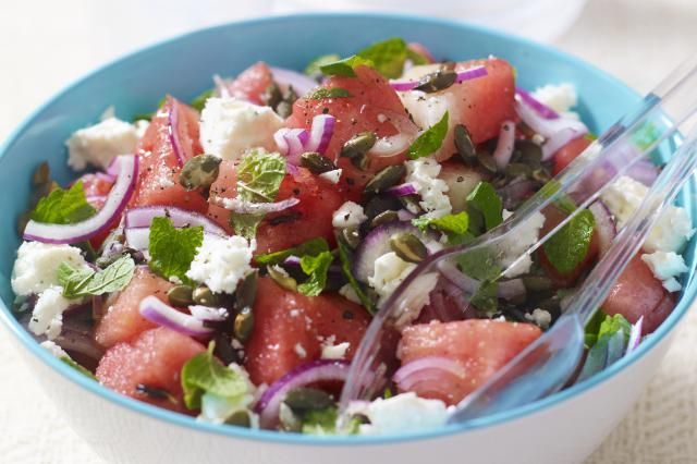 This watermelon salad recipe is cool and refreshing, combining fresh mint, thinly sliced red onion and crumbled feta in a simple balsamic vinaigrette.
