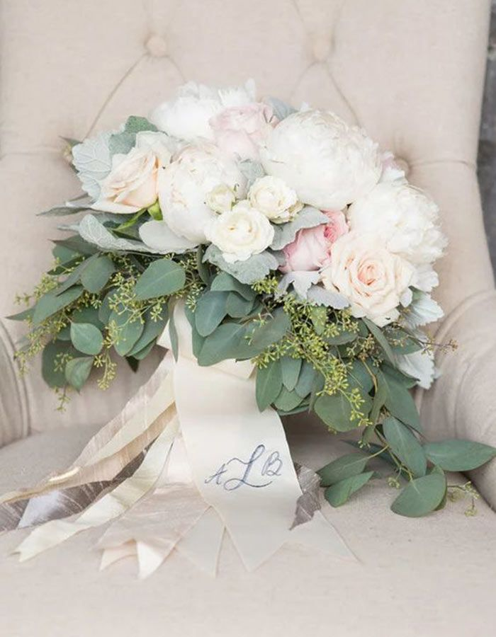 Check out these fun and fresh ways to use your monogram at your wedding, like this gorgeous personalized bouquet wrap!