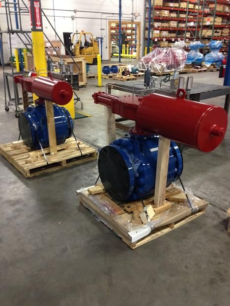 "Shown are 2 each 12"" Cameron TK ball valves with Rotork man power fail safe ESD actuators being prepared to ship to a natural gas processing customer. These units are opened manually (by hydraulics) and stand ready to fail close (by spring) upon 3 conditions: low or high pipeline pressure, or by remote 24vdc command.  http://www.dacriswell.com/valveautomationsolutions.html"