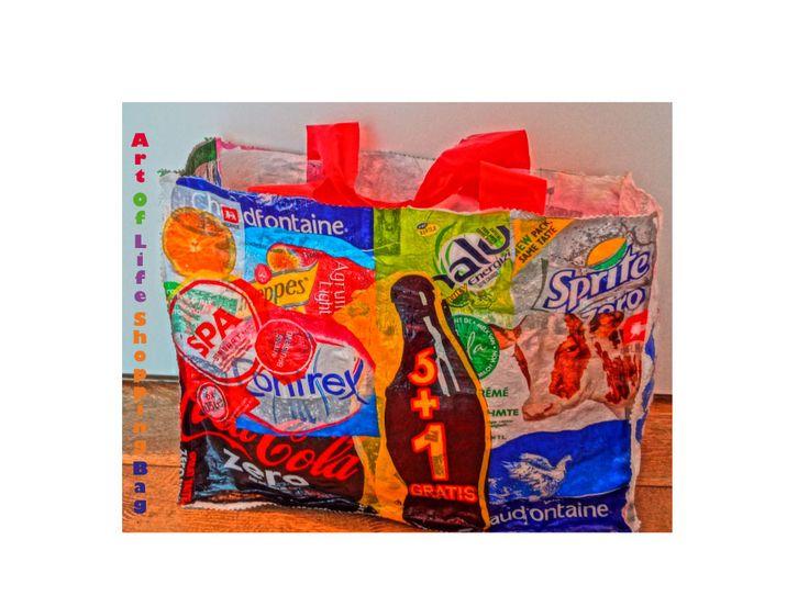 """Een herbruikbare tas, gemaakt door drankverpakkingen te """"fusen"""" (aaneen te strijken). Originele tas, en minder afval op de berg!"""