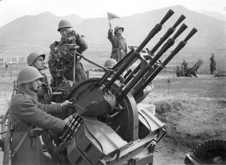 Soldiers of the Albanian People's Army operating a ZPU-4 anti-aircraft gun