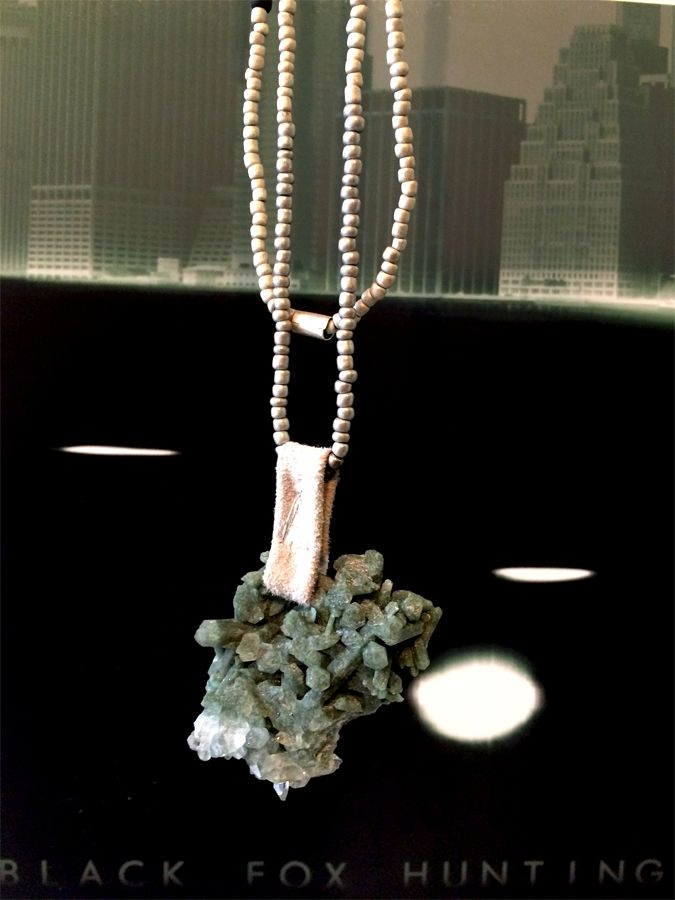 TUARI necklace & the photograph: 'Black Fox Hunting'