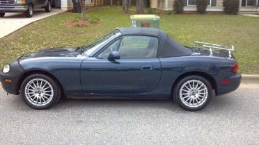 1999 Mazda Miata.  Car rides and handles great!  COLD A/C!  5 Speed.  143,000 odo new top with glass back, new tires less than 4,000 miles and new rims.  $3,000. If interested call Tina at 229-894-6891.