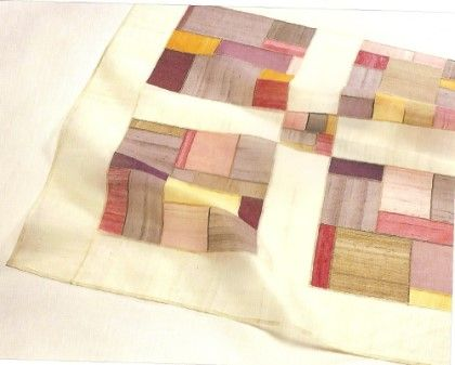 I like the arrangement of the four blocks with the little center block. Borders and sashing are a good idea.