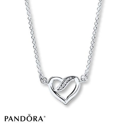Symbolizing strong and everlasting connections between two individuals, this classic sterling silver necklace from the PANDORA Valentine's Day 2017 collection adds a delicate sheen to any outfit. Adjustable in length from 15 to 17.7 inches, the heart-shaped design rests beautifully on the collarbone and compliments any neckline. Style # 590535CZ-45.