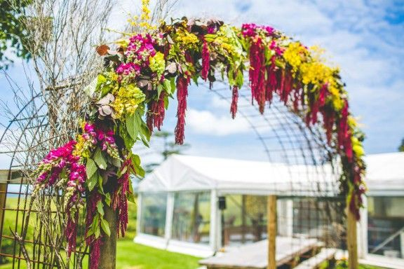 Floral arch by Gypsy Flora | Jess & Nick's Colourful Bush Bank Wedding | Photography by The Evoke Company #weddings #YESevents #YourEventSoluton