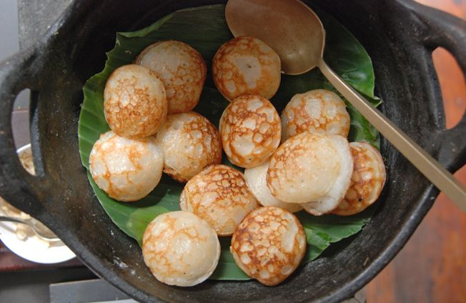 Luang Prabang, LAOS – As you stroll through the night market, chances are you'll end up gobbling down khao nom kok, Lao coconut cakes, addictive and easy to make.
