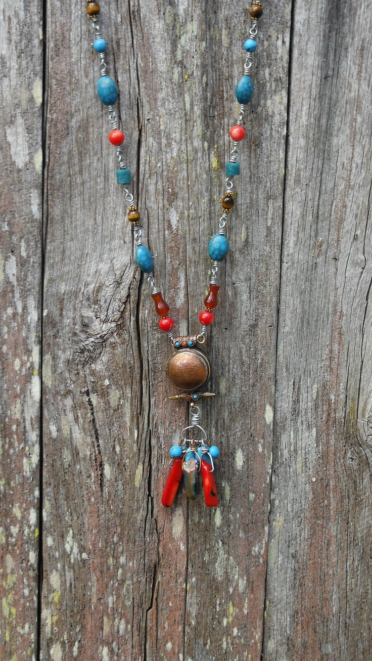 Recently completed piece…  all hand-wound wire linkages.  Featuring a vintage Tibetan locket, with red coral, turquoise, agate, howlite, tigers eye and mystic quartz.    Available in my store: https://www.etsy.com/shop/Quirkville?view_type=gallery
