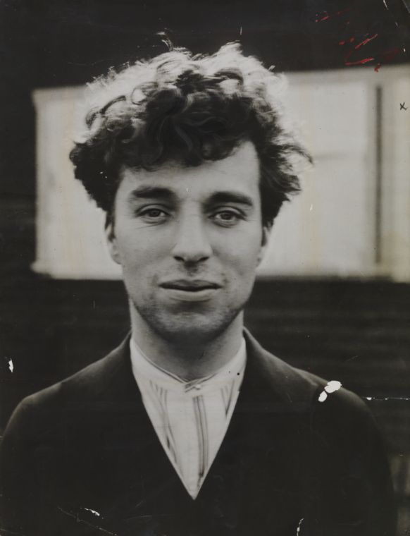 Charlie Chaplin as a young man in Hollywood. I've never seen him out of costume, out of character before.