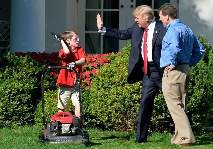 Stop What You're Doing and Look at This Photo of an 11-Year-Old Mowing the WH Lawn With Trump