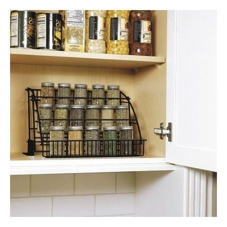 Make use of lofty cabinet space with a pull-down spice rack. | 25 Of The Best Organization Products You Can Buy On Amazon