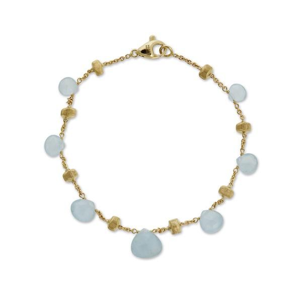 18K yellow gold bracelet with tabeez cut Aquamarine gemstones. A timeless and playful Marco Bicego classic, this Paradise Aquamarine Gemstone Bracelet is hand engraved by Italian artisans and composed of hand picked stones.