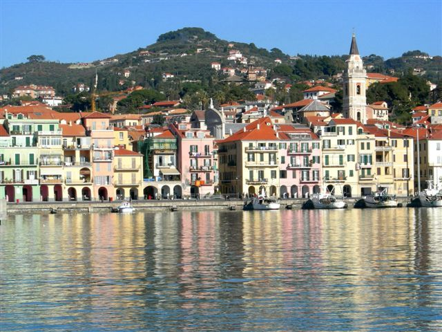 The water of the port mirrors Oneglia