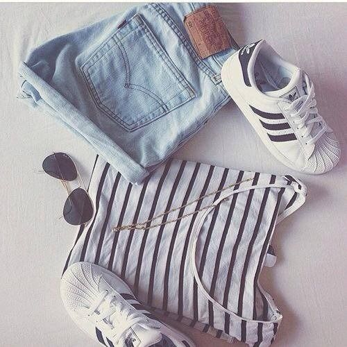 Denim shorts, black and white stripped shirt, aviator shades and black and white adidas shell tops