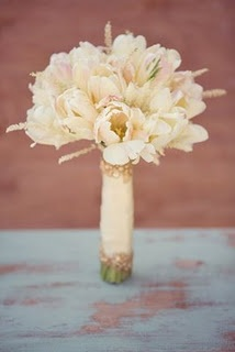 Parrot tulip bouquet with a touch of astilbe. Beautiful ribbon as well.