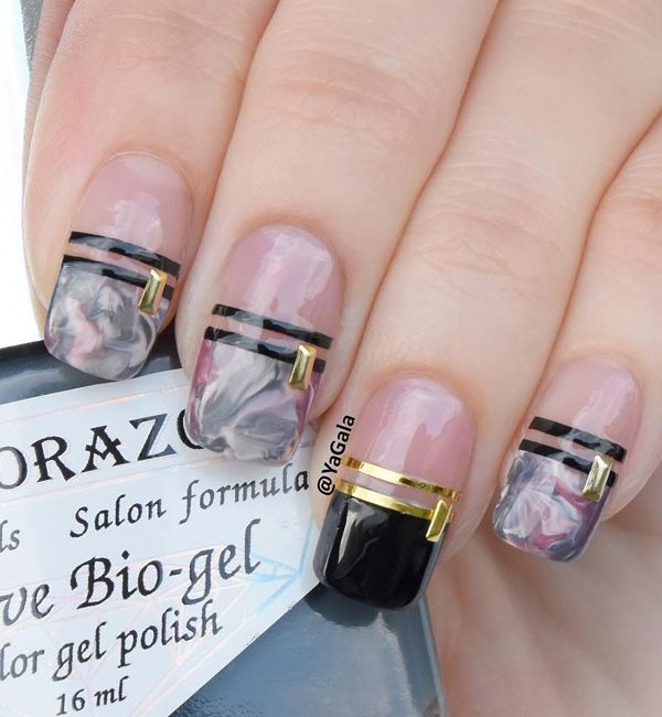 Marble designed spring nail art. Make your French tips stand out with the marble inspired gray and pink combination. Outline them with thin black polish lines and add gold embellishments and foil on top for the lines.