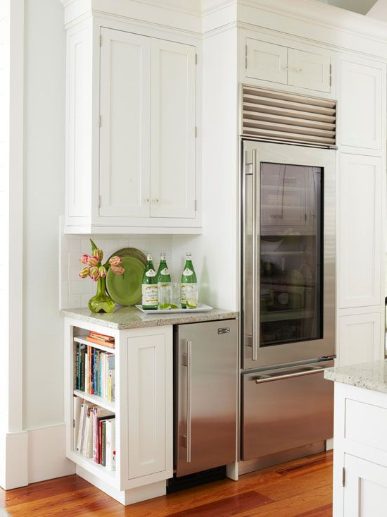 Book Nook: Keep cookbooks on hand in the kitchen with a small built-in bookshelf. This bookshelf makes use of an awkward space left over from the addition of an icemaker.