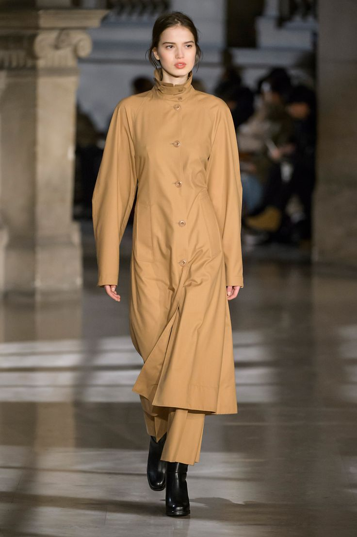 10. Overcoat and large pants in water-repellent poly-wool twill, boots in leather