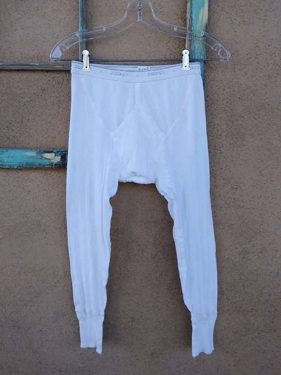 White Ribbed stitch Elastic waist Ankle cuffs NOT thermal but a great layering piece Open fly Cotton/poly blend Feels soft Stretchy Warm Note that these are meant to be worn as abbreviated long underwear not pant length. When you purchase this listing, you get: 1 (ONE) pair as seen in