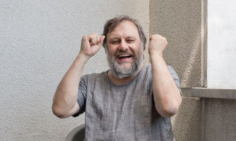 "Slavoj Žižek at his home in Lubljana.    Slavoj Žižek doesn't know the door number of his own apartment in Ljubljana. ""Doesn't matter,"" he tells the photographer, who wants to pop outside. ""Come back in through the main door, and then just think in terms of politically radical right; you turn from left to right, then at the end, right again."""