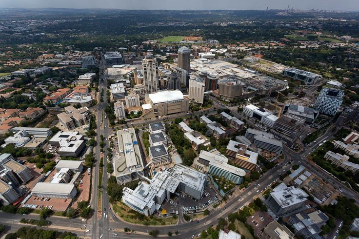 An aerial view photograph of Sandton Central Business District featuring The Sandton Convention Centre.