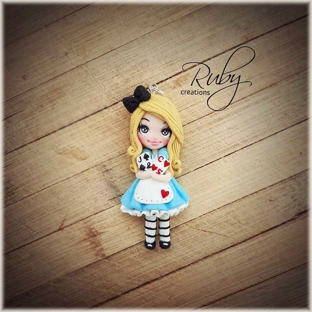 #Aliceinwonderland #polymerclay #necklace #pendant #fimo #doll #jewelry #cards #blue #bow #handmade #handcrafted #craft #design #rubycreations #disney #cartoon #movie #moviecharacter