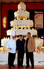 The largest wedding cake weighed in at 6.818 tonnes (15,032lb), and having been created by chefs at the Mohegan Sun Hotel and Casino (Connecticut, USA), was displayed at their New England bridal showcase on 8 February 2004. That's about 600 times the weight of an average wedding cake!