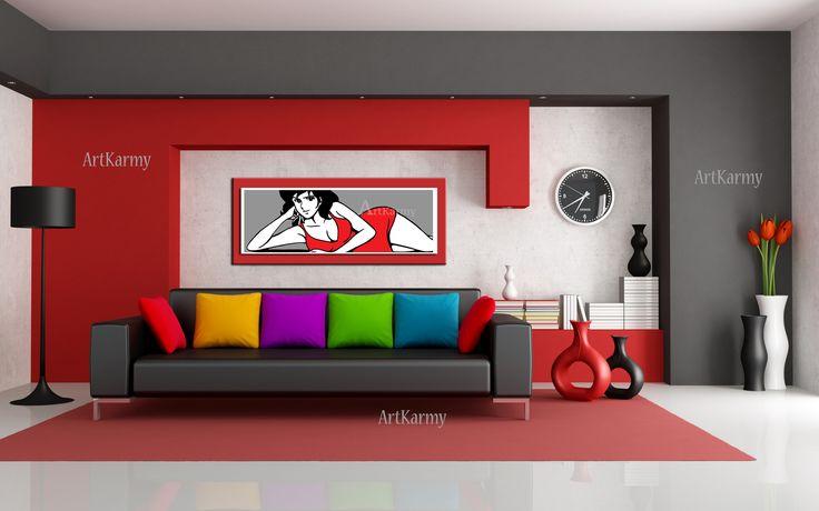 Un altro esempio di ambiente moderno con colori predominanti rosso bianco e grigio. Il complemento d'arredo posto sopra il divano è di dimensioni 50×100 cm su cornice rossa. Interessante anche l'abbinamento con i cuscini colorati.  I quadri di Lupin potete trovarli nella sezione del mio blog quadri moderni Lupin