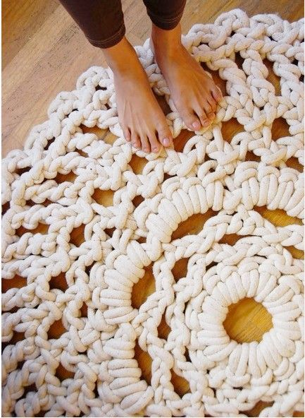 ANY Doily design could be converted to this rug style; oval, round, square etc. Do it without a hook, just use your hands if you know how to crotch. As for heavy; just use the size cotton rope you want, doesn't have to be this heavy.