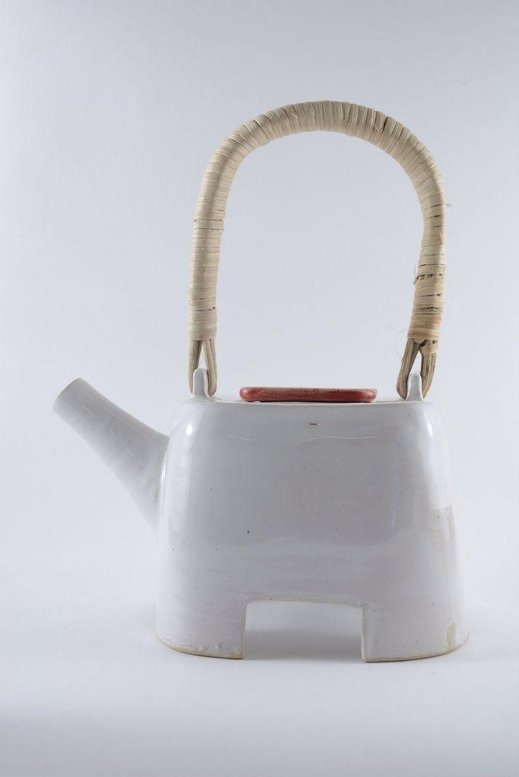 Teapot, White tin glaze cone 6 ratan handle. Four cups.