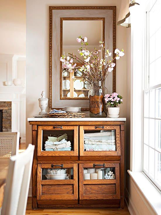 Deep drawers make an antique grain bin well suited for storing dinner-party staples, such as candles, table linens, and special-occasion china.