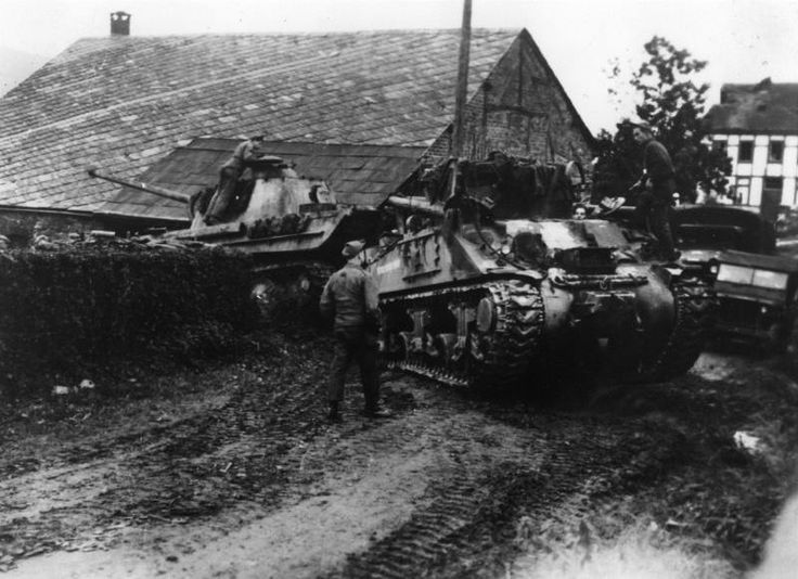 US armored recovery vehicle removing a knocked out Panther from La Gleize after the Battle of the Bulge.