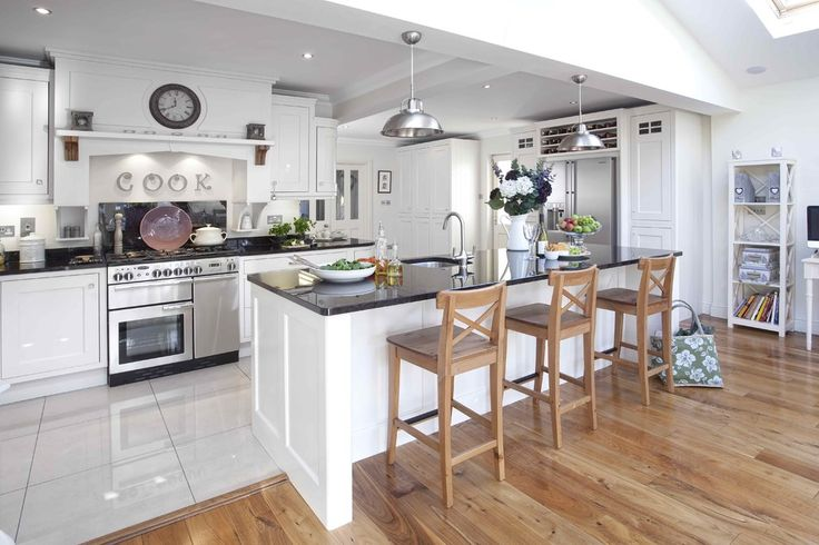 kitchen floors with white cabinets Kitchen Contemporary with black granite breakfast bar